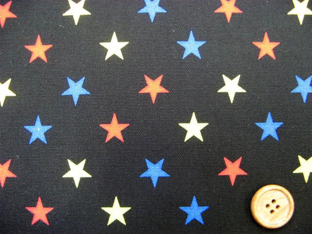 画像1: 星柄 3色の星 オックス生地 (黒地)