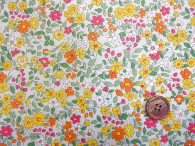 画像1: 撥水加工 ナイロンオックス生地 黄色とオレンジ色の小花柄