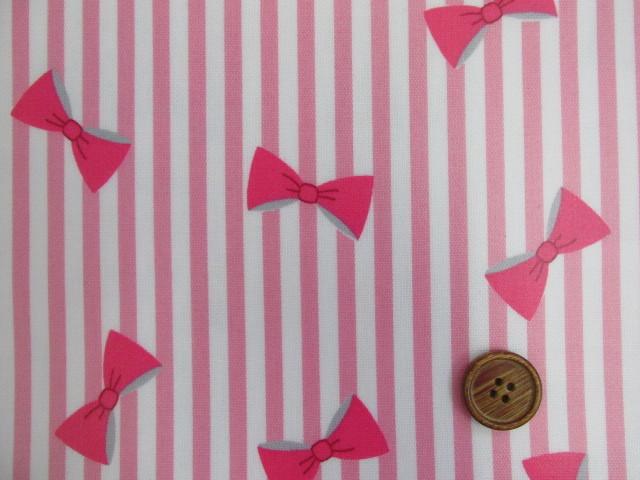 画像1: ▼キュートリボン・ストライプ柄 オックス生地   ラミネート つや消し (ピンク) ◆訳ありはぎれ50cm
