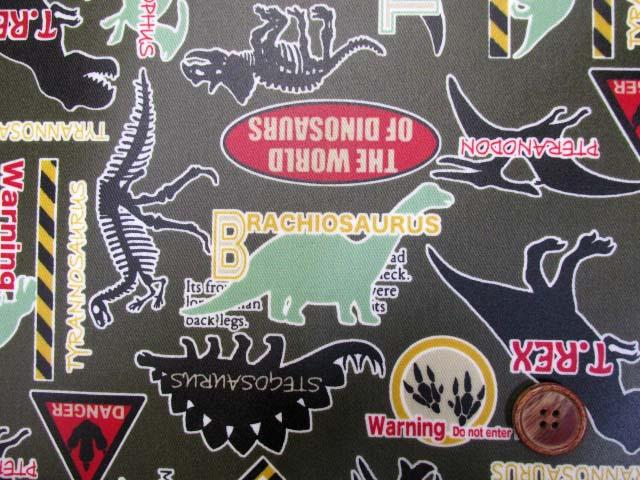 画像1: 恐竜・ダイナソー・warning柄 (カーキグリーン) ツイル生地 ラミネート つや消し